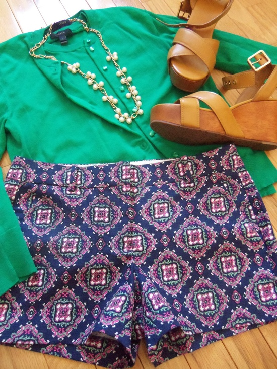 Green shirt with patterned shorts
