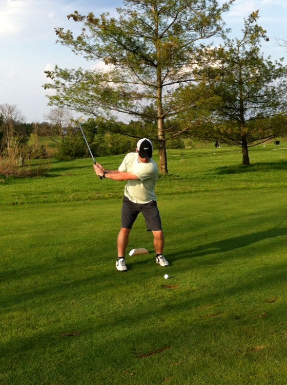 Random photo of B playing golf in the summer!
